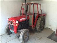 Shes traktorin me pllugj