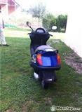 Grand  skuter  -00