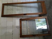 Dritare dhe nje der me qmim shume te lir