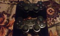PlayStation 2 me dy gjistka dhe 17 cedeja
