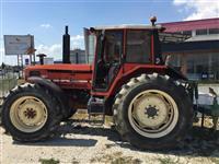 Traktor me pllugj me frez dhe  pjese tjera bujqeso