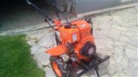 Kultivator dizell-Nderrim me rimorkio traktori