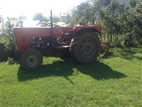 Traktor me prikolic Ele plug