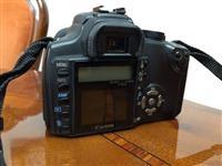 Shes 2 Nikona dhe 1 Canon