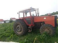 shitet traktori 77